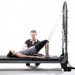 Pilates Shoulder bridge na Reformeru s Věží